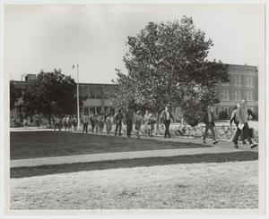Primary view of object titled '[Photograph of Line of Students Leaving Cooke Building]'.