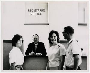 Primary view of object titled '[Photograph of McMurry College Registrar's Office with Students]'.