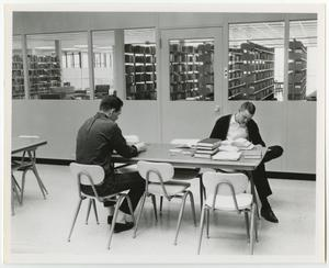 Primary view of object titled '[Photograph of Studying at a Table in the Jay-Rollins Library]'.