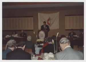 Primary view of object titled '[Photograph of Dr. Monk at Prayer Breakfast]'.