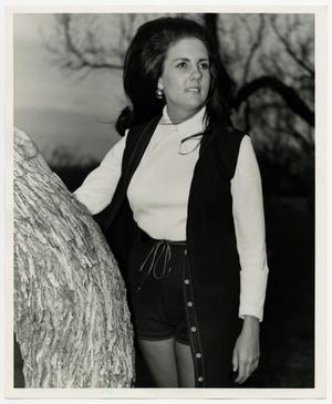Primary view of object titled '[Photograph of Kathy Fulls by Tree]'.