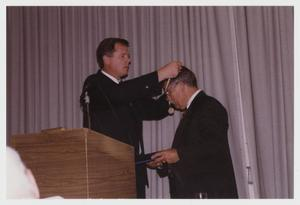 Primary view of object titled '[Photograph of Dr. Shimp Recieving Rotary International Award for Fellowship]'.
