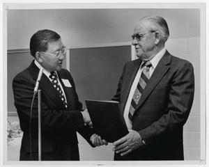 Primary view of object titled '[Photograph of Dr. Thomas Kim and Mr. Hunt]'.