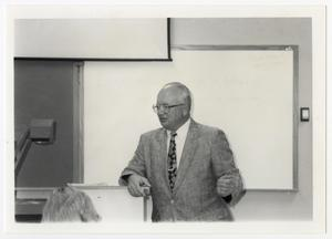 Primary view of object titled '[Photograph of Terry Northrup Lecturing]'.