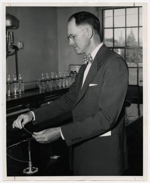 Primary view of object titled '[Photograph of Dr. W. Norton Jones, Jr., with a Bunsen Burner]'.