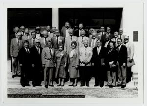 Primary view of object titled '[Photograph of Dr. Thomas Kim and the Board of Trustees]'.