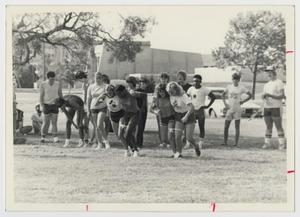 Primary view of object titled '[Photograph of Three-Legged Race]'.