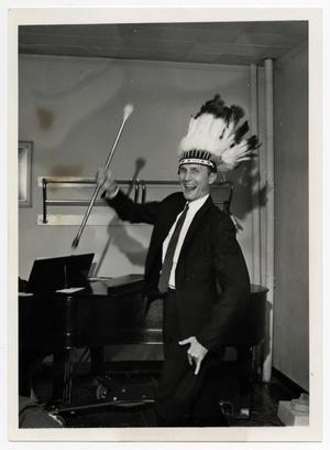 Primary view of object titled '[Photograph of Professor Wearing Feathered Headdress]'.