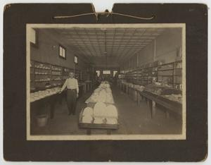 Primary view of object titled '[Photograph of J. L. Crawford in Store]'.