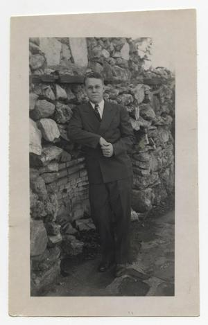 Primary view of object titled '[Photograph of Reverend R. C. Stone by Rock Wall]'.