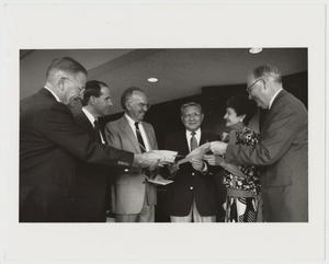 Primary view of object titled '[Photograph of Dr. Kim Receiving Pledge Certificates]'.