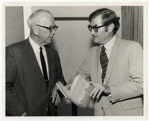 Primary view of object titled '[Photograph of George Steinman and A. C. Greene, Jr. Talking]'.