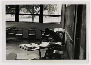 Primary view of object titled '[Photograph of Student Sleeping in Classroom]'.