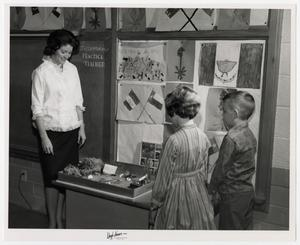 Primary view of object titled '[Photograph of Practice Teacher With Students]'.