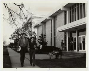 Primary view of object titled '[Photograph of Couple Walking by Finch-Gray Science Center]'.