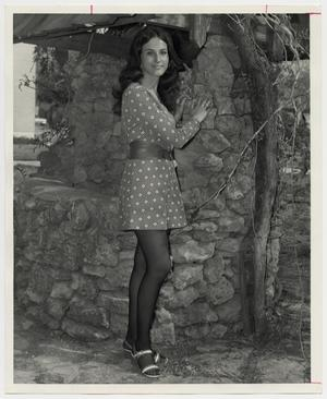 Primary view of object titled '[Photograph of Teresa Moring by Wishing Well]'.
