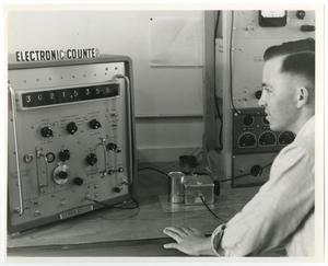 Primary view of object titled '[Photograph of Student Working with Electronic Counter]'.