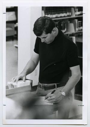 Primary view of object titled '[Photograph of Student Using Card Catalog]'.