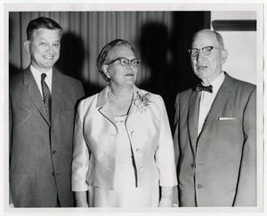 Primary view of object titled '[Photograph of J. M. Willson, Sr., Dr. Mavis Terry Willson, and Dr. Douglas Jackson]'.