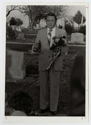 Primary view of object titled '[Photograph of Dr. Kim at the Hunt Family Monument]'.