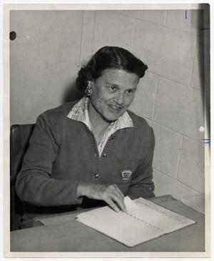 Primary view of object titled '[Photograph of Vernie Newman with Gradebook]'.