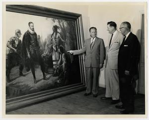 Primary view of object titled '[Photograph of Men Examining Painting]'.
