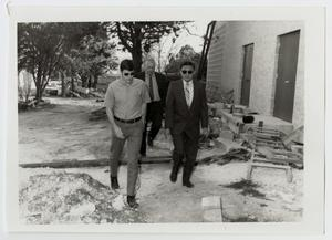 Primary view of object titled '[Photograph of Dr. Kim at Construction Site]'.