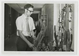 Primary view of object titled '[Photograph of Dr. Ben Pilcher with Cacti]'.