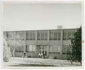 Primary view of object titled '[Photograph of Students Walking Away from Classroom Building]'.