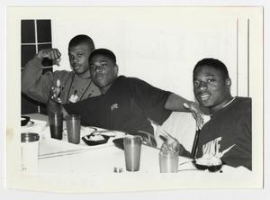 Primary view of object titled '[Photograph of Three Men in Cafeteria]'.