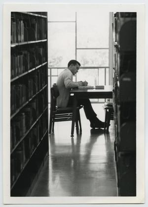 Primary view of object titled '[Photograph of Student Studying at the Library]'.
