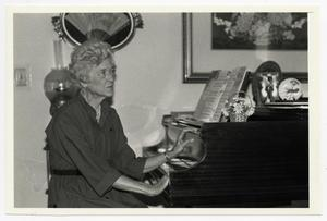 Primary view of object titled '[Photograph of Boog Eyssen at a Piano]'.