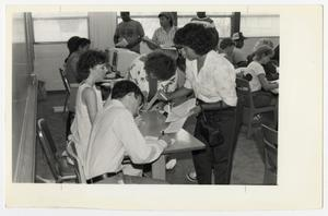 Primary view of object titled '[Photograph of Students Registering for Classes]'.