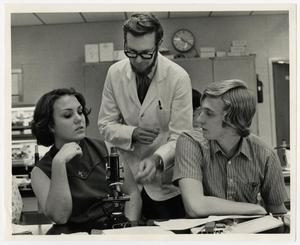 Primary view of object titled '[Photograph of Dr. Ben Pilcher With Two Students]'.