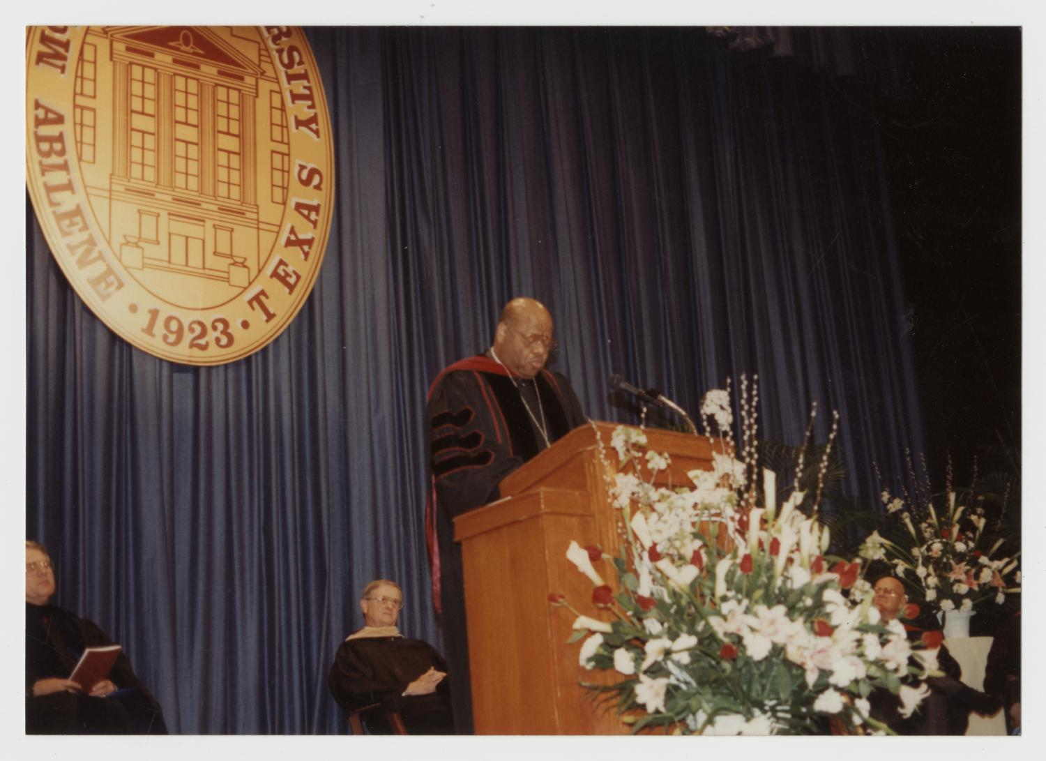 [Photograph of Bishop Norris at Dr. Shimp's Inauguration Ceremony]                                                                                                      [Sequence #]: 1 of 2