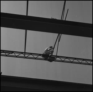 Primary view of object titled '[Workman on Steel Girders of Jay-Rollins Library]'.