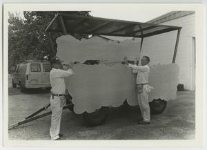 Primary view of object titled '[Photograph of Men Refurbishing McMurry Calliope]'.