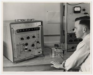 Primary view of object titled '[Photograph of Student With Electronic Counter]'.