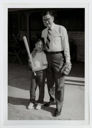 Primary view of object titled '[Photograph of Dr. Kim and His Son]'.