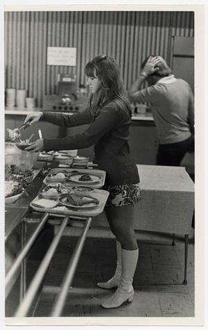 Primary view of object titled '[Photograph of Student Getting Food]'.