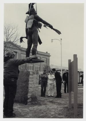 Primary view of object titled '[Photograph of Workman Balancing Sacred Wind]'.