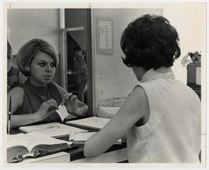 Primary view of object titled '[Photograph of Student at Counter]'.