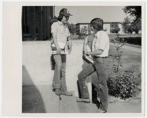 Primary view of object titled '[Photograph of Two Students on Steps]'.