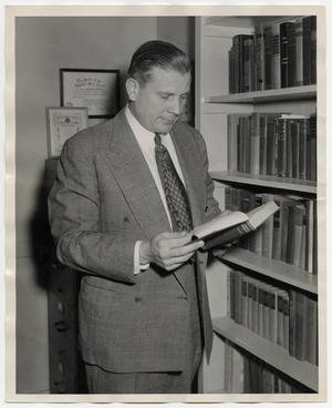 Primary view of object titled '[Photograph of Andrew Hunt with Book]'.