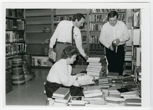 Primary view of object titled '[Photograph of Library Staff Preparing for Book Sale]'.