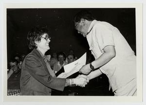 Primary view of object titled '[Photograph of Dr. Thomas Kim Presenting an Award]'.
