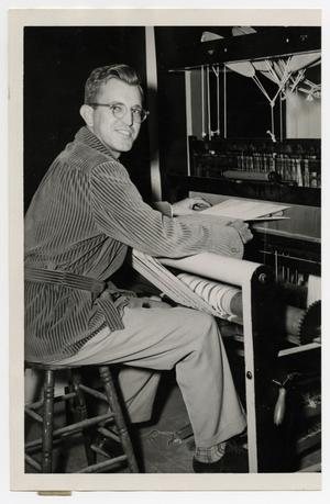 Primary view of object titled '[Photograph of Frank McCullough at Loom]'.
