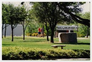 Primary view of object titled '[Photograph of Students Walking Across Campus]'.