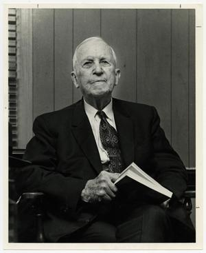 Primary view of object titled '[Photograph of Dr. O. P. Clark Seated with Book]'.