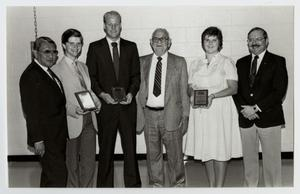 Primary view of object titled '[Photograph of Dr. Thomas Kim with Student Award Winners]'.